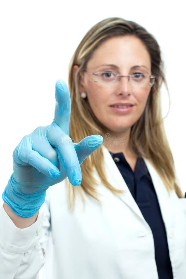 Doktorfrau, die etwas mit seinem Finger zeigt lizenzfreie stockfotos