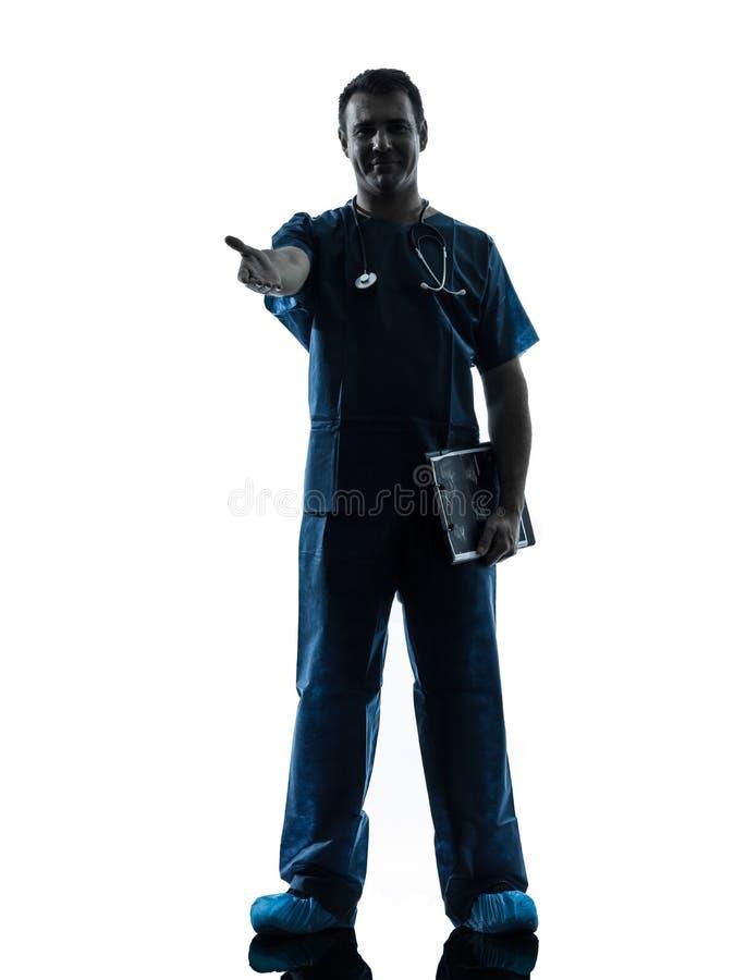 Doktormannschattenbild, das in voller Länge steht, Händedruck gestikulierend stockbild