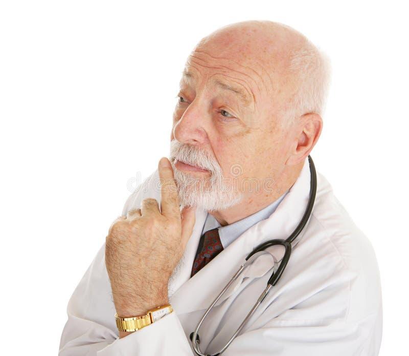 doktorn över tänker fotografering för bildbyråer