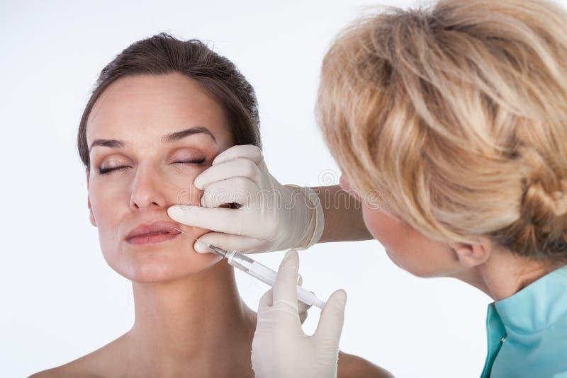 Doktorski robić usta botox zdjęcie stock