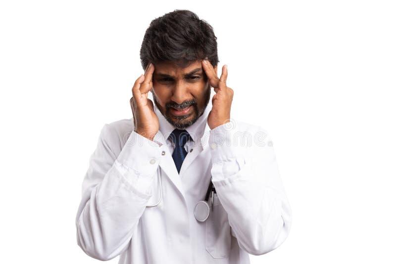 Doktorski wzruszający czoło jako migrena gest obrazy royalty free