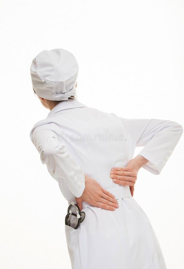 Doktorski wzruszający mały plecy zdjęcie stock