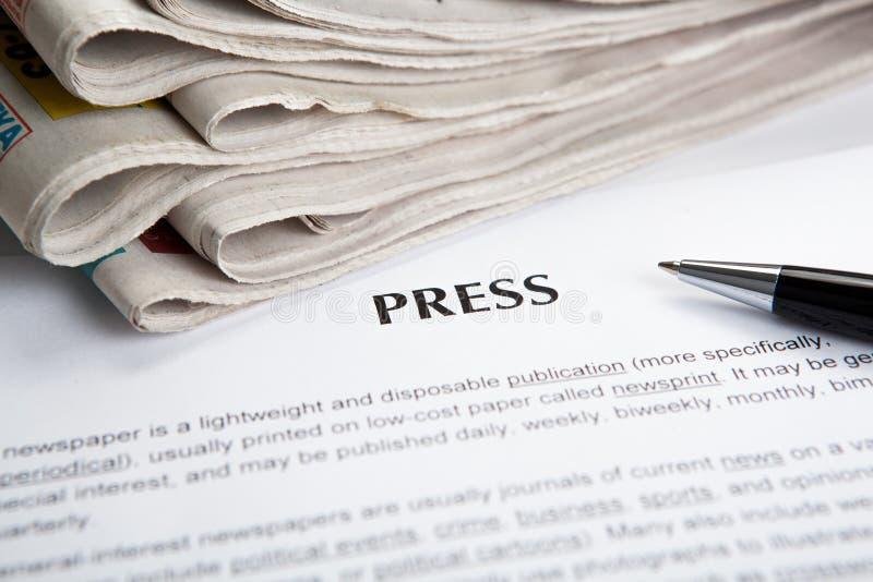 Dokument med titeln av press royaltyfri fotografi
