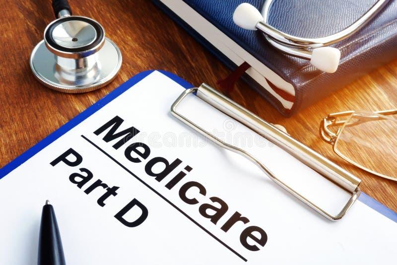 Dokumente Medicare-Teils D mit Klemmbrett lizenzfreie stockfotografie