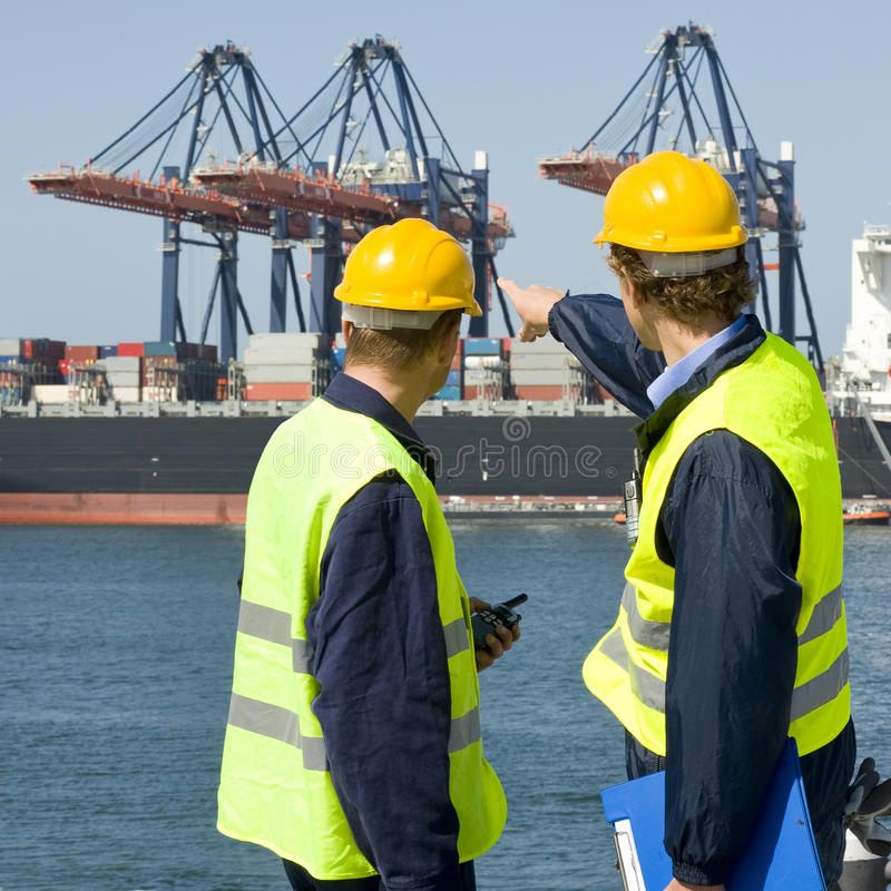 Dokwerkers in bespreking royalty-vrije stock afbeeldingen
