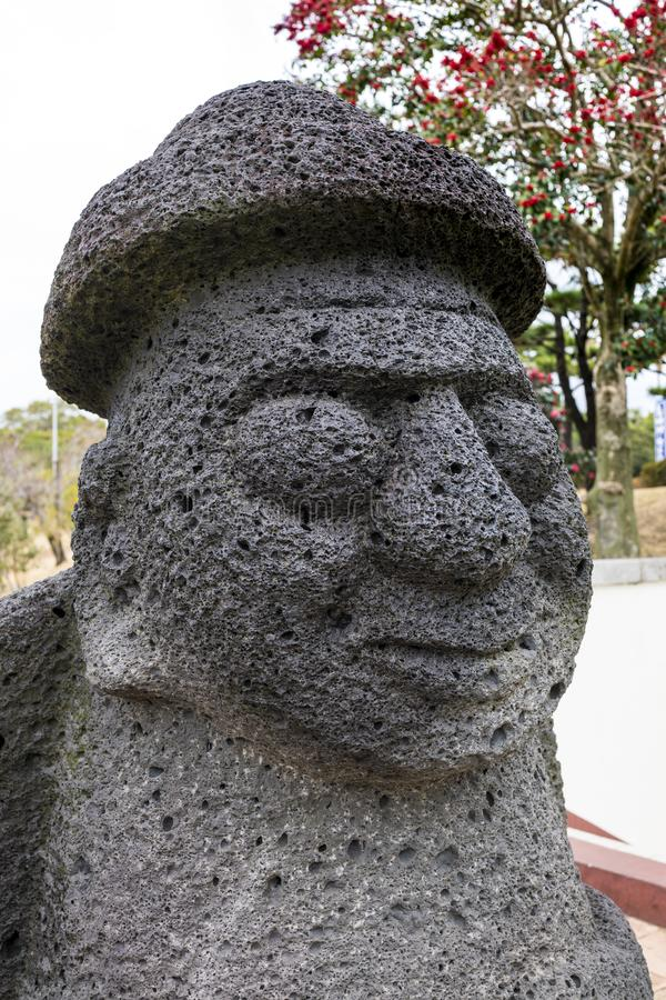 The Dol Hareubang at Jeju Island. Dol Hareubang are stone statues that can be found all around Jeju Island. Carved from the island's porous volcanic rock royalty free stock images