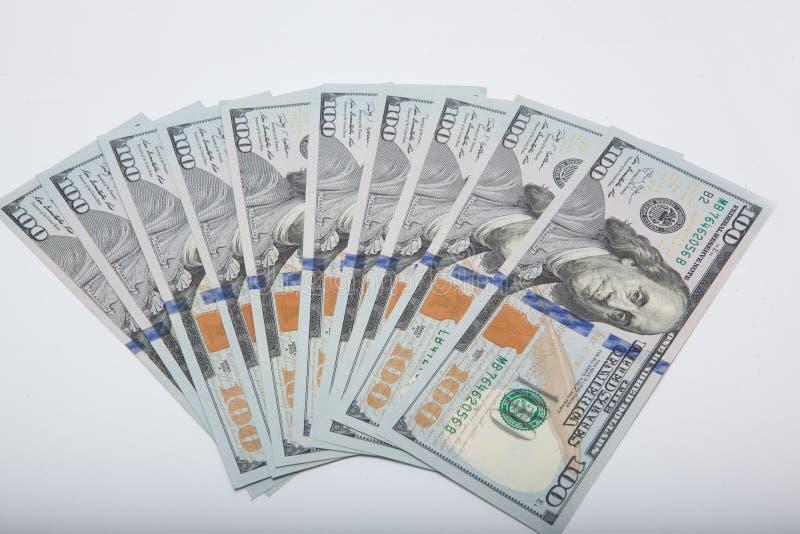 100 dolarów banknotów odizolowywających na białym tle zdjęcie royalty free