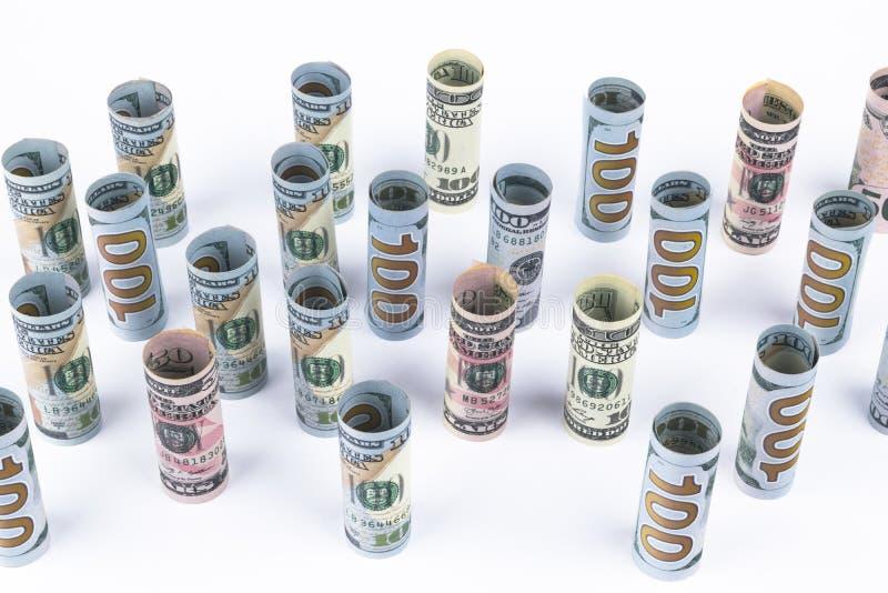 dolar Dolarowa banknot rolka w inny pozycje Amerykańska USA waluta na białej desce Amerykańskie dolarowe banknot rolki zdjęcia stock