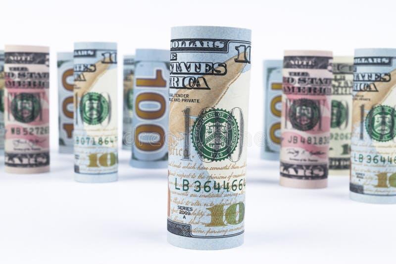 dolar Dolarowa banknot rolka w inny pozycje Amerykańska USA waluta na białej desce Amerykańskie dolarowe banknot rolki obraz royalty free