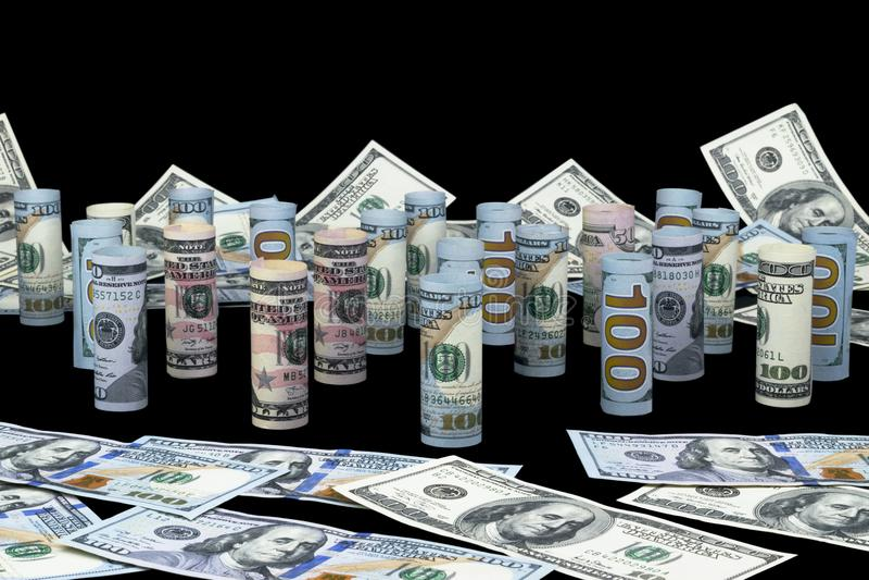dolar Dolarowa banknot rolka w inny pozycje Amerykańska USA waluta na czerni desce Amerykańskie dolarowe banknot rolki zdjęcia royalty free