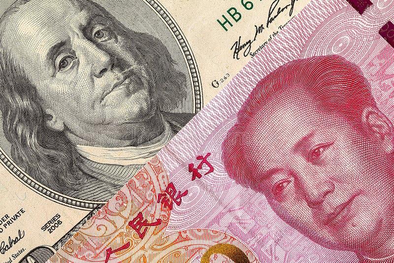 dolara amerykańskiego rachunek i Chiny Juan banknot makro- obrazy stock