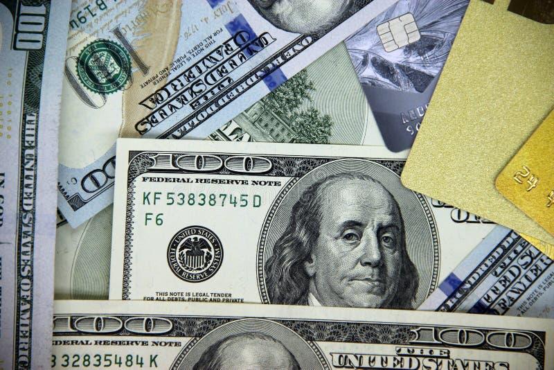 Dolarowi rachunki i kredytowe karty zdjęcie royalty free