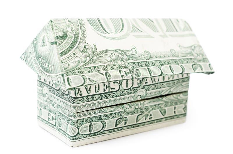 Dolarowy origami dom odizolowywający obraz royalty free
