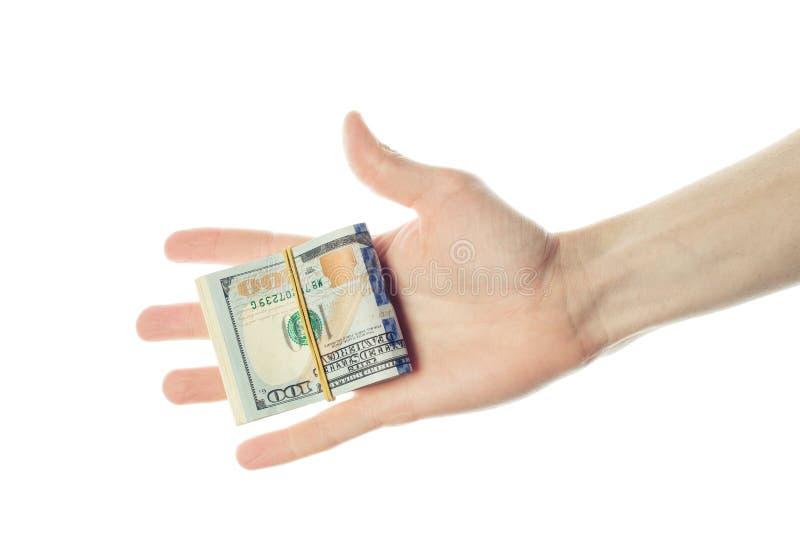 Dolary spieniężają pieniądze w ludzkiej ręce odizolowywającej na bielu Kredytowy ryzyko przy 100 dolarów banknotu pojęciem fotografia stock