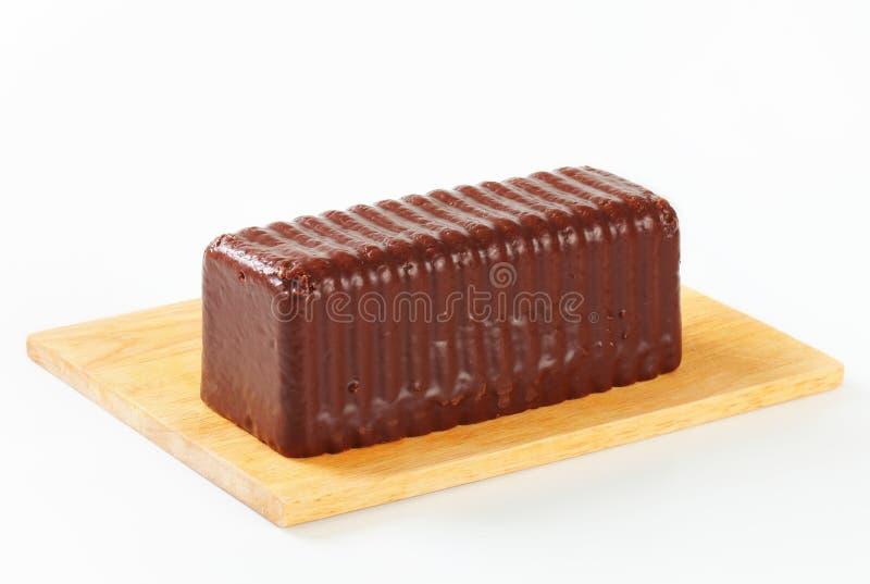 Dolce coperto di cioccolato della libbra immagine stock libera da diritti