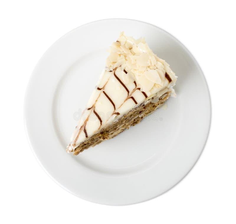 Dolce delizioso con i dadi e la cioccolata bianca fotografia stock libera da diritti