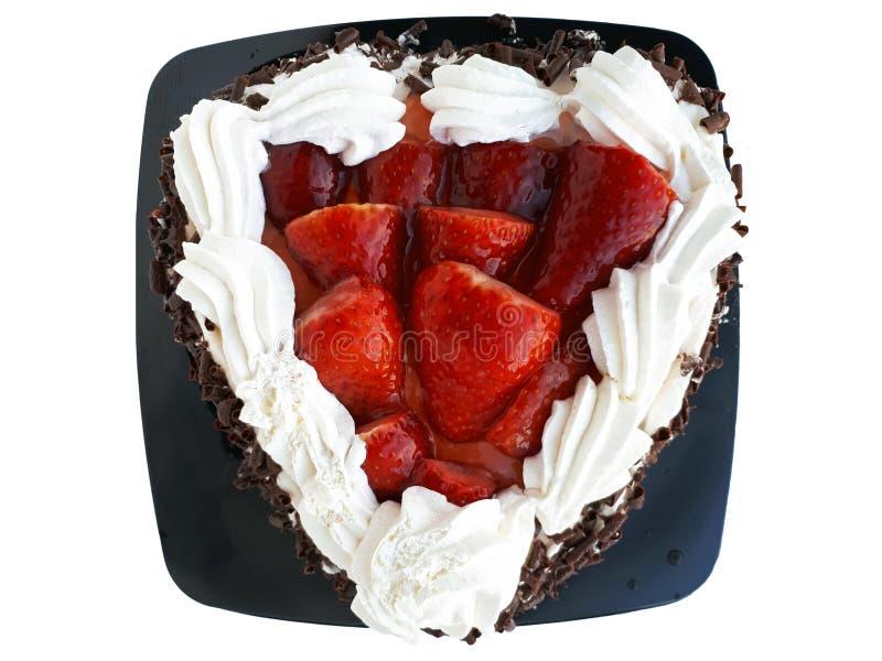 Dolce di cioccolato e della crema con gli streawberries immagini stock