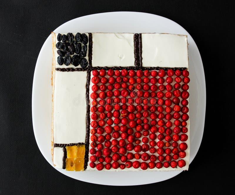 Dolce quadrato su un fondo nero Dolce di Mondrian immagine stock libera da diritti
