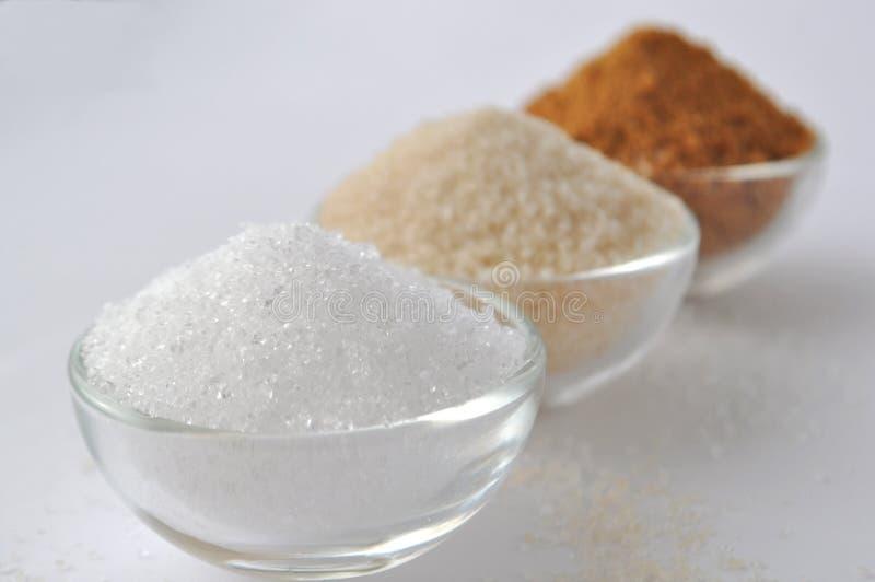 Dolcificanti alternativi - zucchero organico della noce di cocco, xilitolo, zucchero di canna, fotografia stock libera da diritti