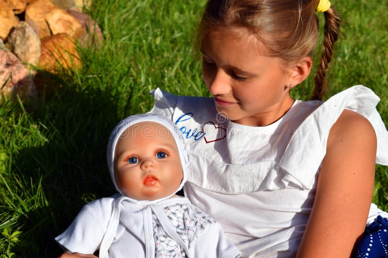 Doll as real person. Doll with a human face stock image