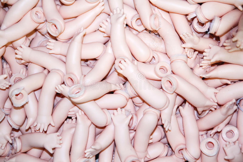 Doll Body Parts. Broken Doll Body Parts in the box royalty free stock image