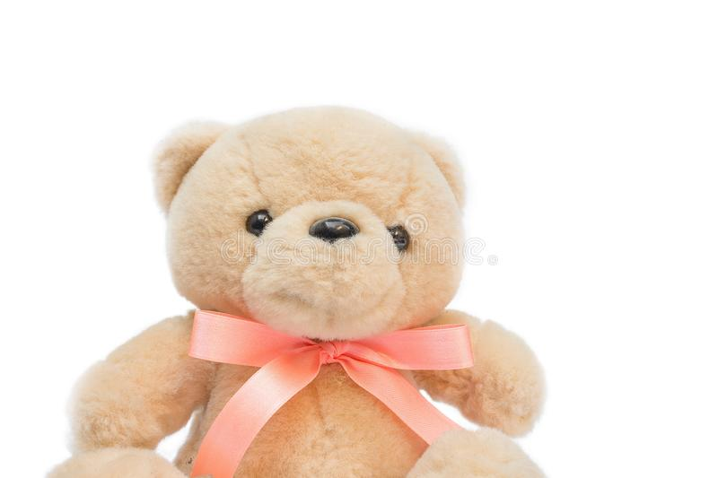 Doll Brown teddy bear with a ribbon on white background. Teddy Knitting by hand toy for children royalty free stock photography