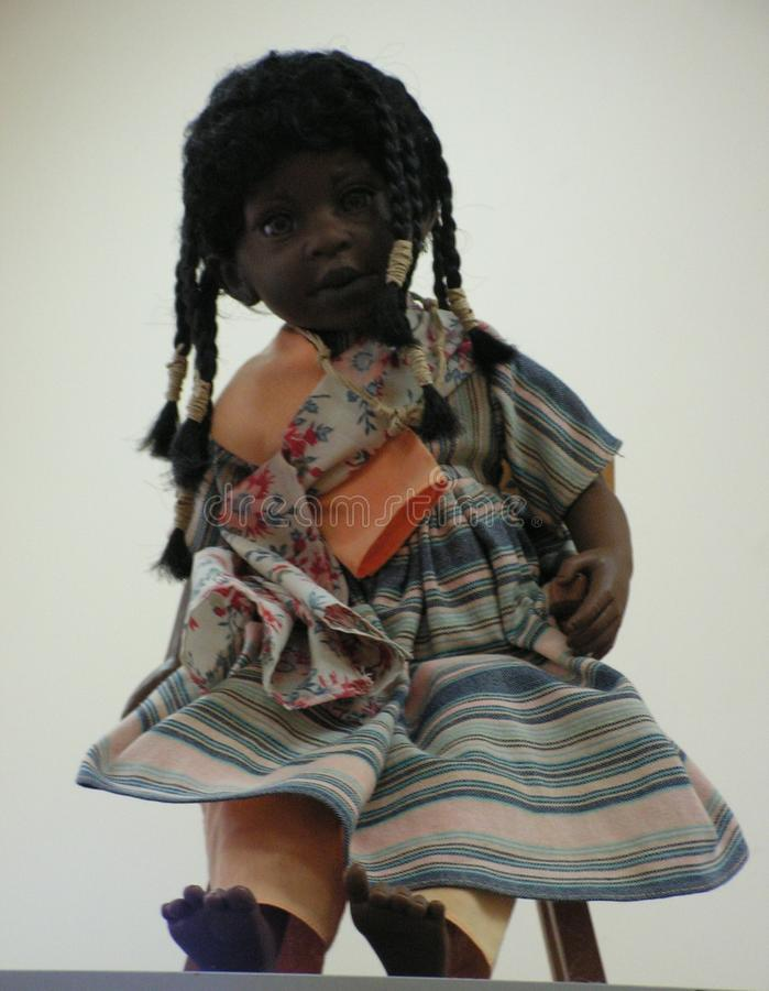 The doll is a children`s toy. A doll is a children`s toy royalty free stock photos