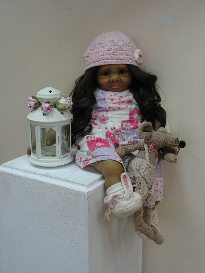 The doll is a children`s toy. A doll is a children`s toy royalty free stock photo
