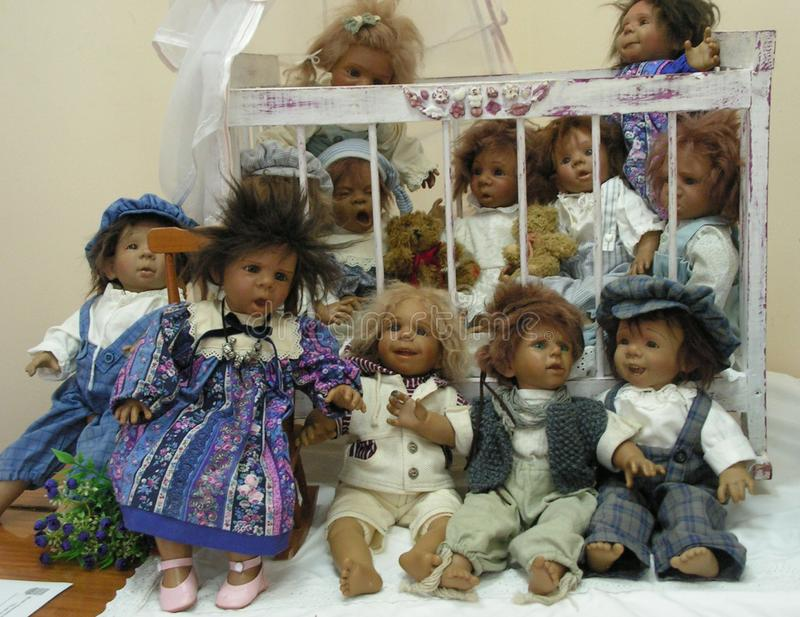 The doll is a children`s toy. A doll is a children`s toy royalty free stock photography