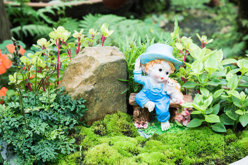 Doll clay decorating your garden. Doll clay cute for decorating your garden royalty free stock image