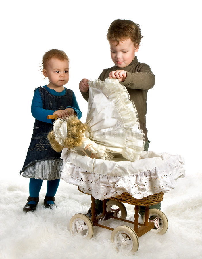 Doll in a cradle stock photos