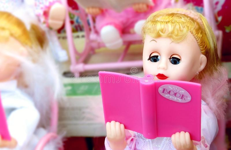 Doll with extra pink stock photography