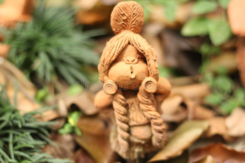 Doll in garden. My home stock image