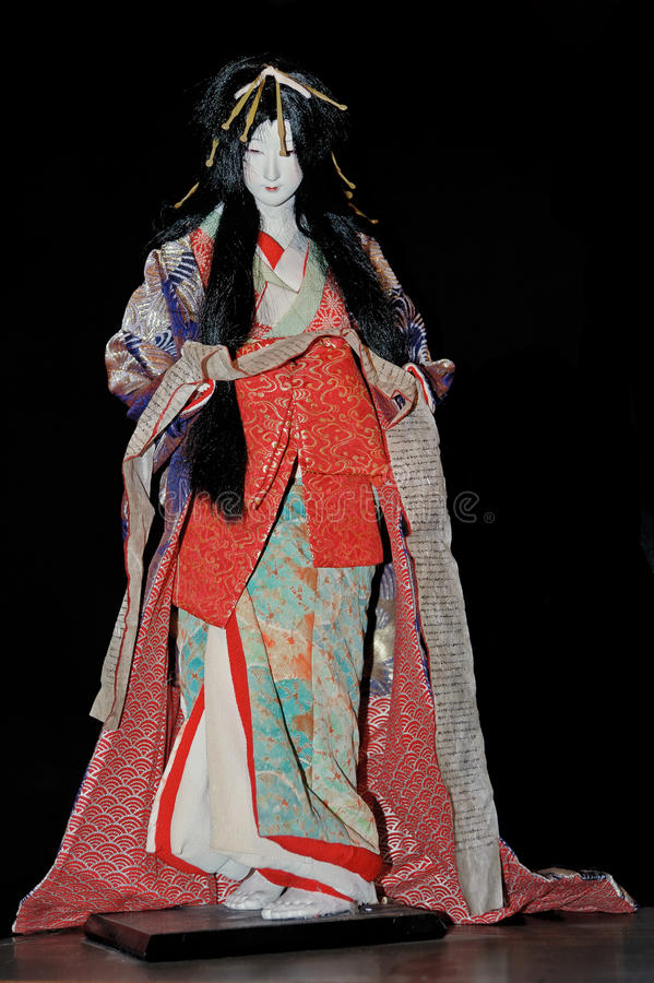 The doll of geisha in the traditional kimono stock photo