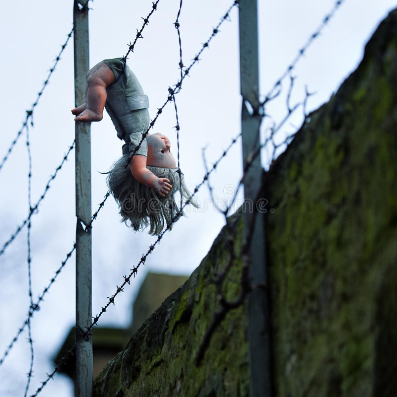 Man Climbing Over Barbed Wire Fence Stock Photo - Image of climb, danger: 19070614