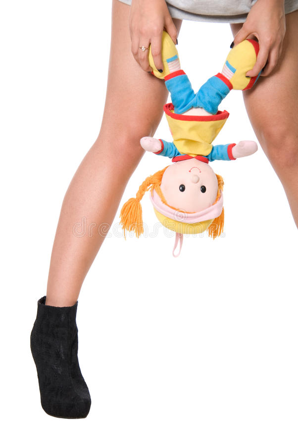 Download Doll Hangs On A Hand At Girl Between Feet Stock Image - Image: 25883901