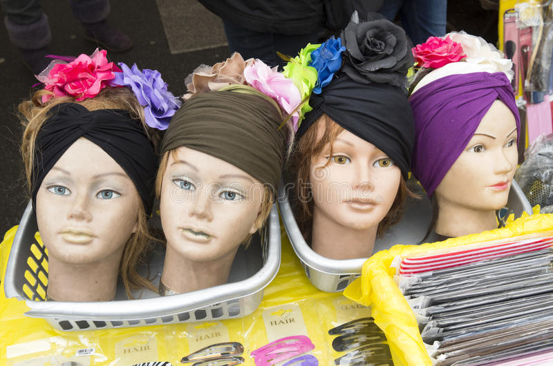Doll heads with hair decoration. Doll heads with hair decoration on the Albert Cuyp market in Amsterdam, Netherlands royalty free stock images