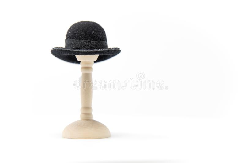 Doll House Fashion Bowler Hat on a small hat stand with a clean royalty free stock photography