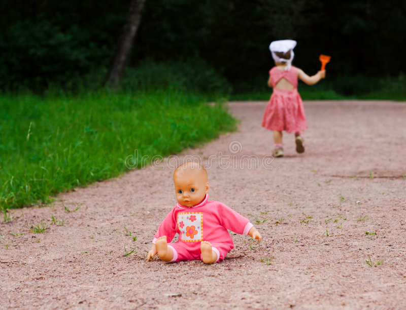Doll left by a small girl stock photos
