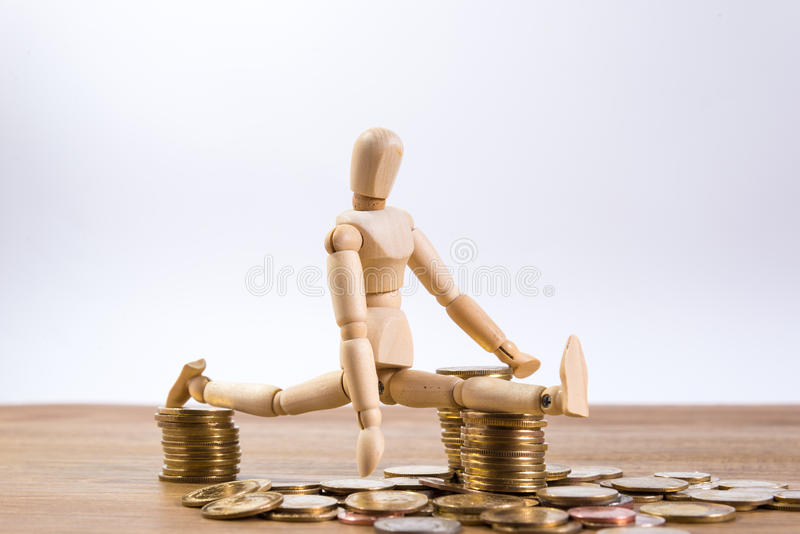 A doll man with his saving money royalty free stock photography