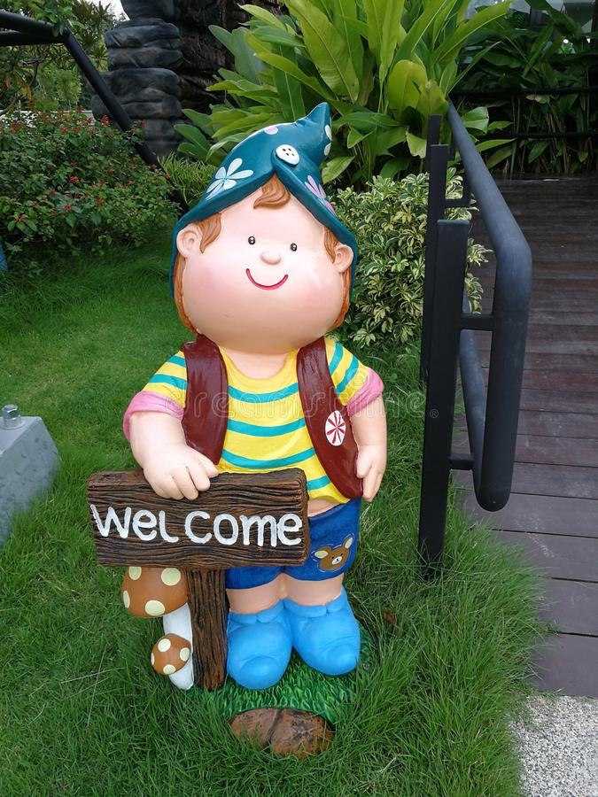 Cute doll ceramic pottery molds decorated the garden with the word welcome royalty free stock image