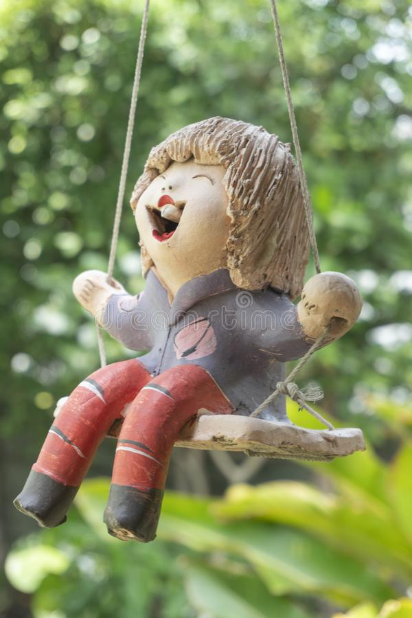Doll sculpture on the garden. Abstract background stock image