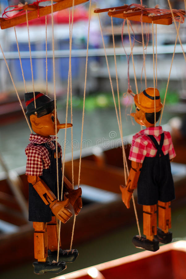 Doll wood Pinocchio handmade puppet retro toy royalty free stock image