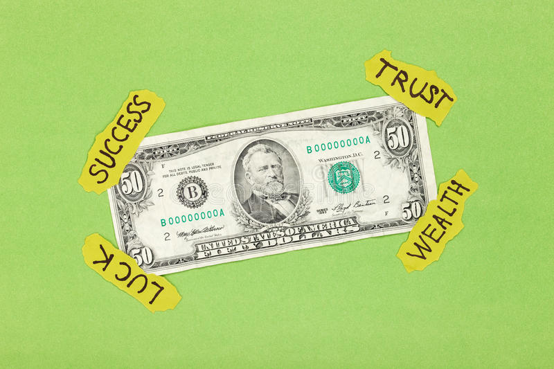 Dollar analyzing concept. Dollar attached on green background with paper symbol sticks. Creative money concept royalty free stock image