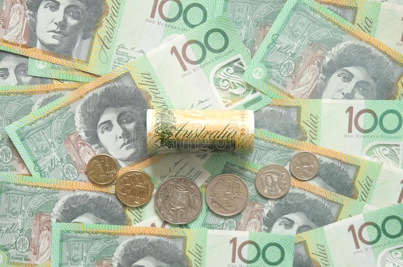 Dollar australian banknote and coins. Focus on `Australia` wording on banknote royalty free stock photos