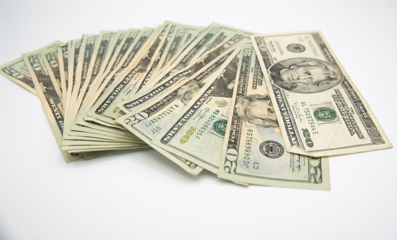 Twenty american dollars bills on a white background royalty free stock photo