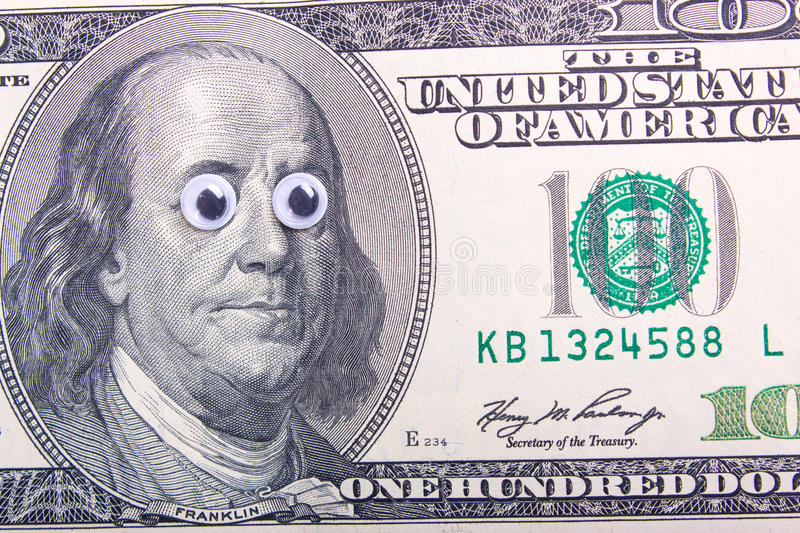 Dollar with big eyes. 100 dollar bill with big eyes of the president. Surprised dollar concept stock photography
