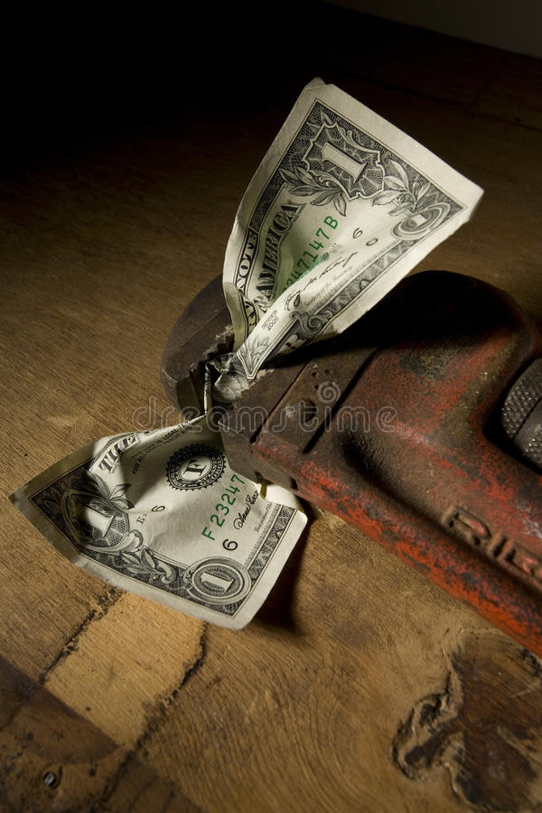 Dollar Bill Crimped In Wrench Stock Images