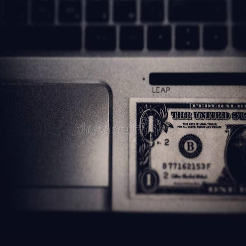Dollar bill on laptop