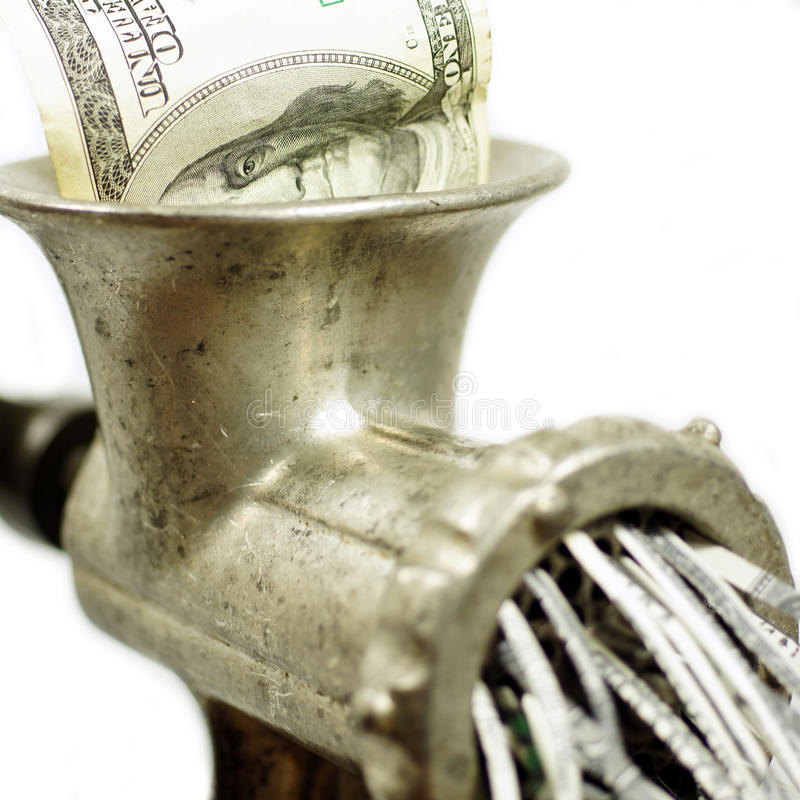 100 dollar bill in a meat grinder. 100 dollars note in a meat mincer in a conceptual photograph royalty free stock photography